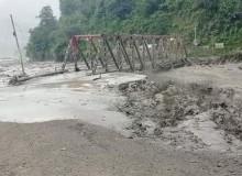 मेलम्ची बाढी : चनौटेको रातो पुल बगायो [अपडेट]